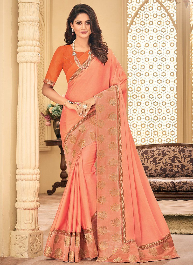 Light Pink And Orange Embroidered Silk Saree Features A Beautiful