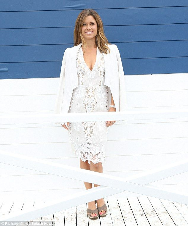 Classic: Channel Nine news presenter Amber Sherlock also opted for white on the day,