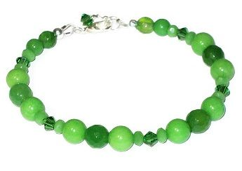Complement your outfit with this apple green faceted agate and smooth jade bracelet which is accented with Swarovski crystals and faceted Czech glass rondelles. It has a silver plated lobster clasp and can be extended from 7 to 7.5 inches.