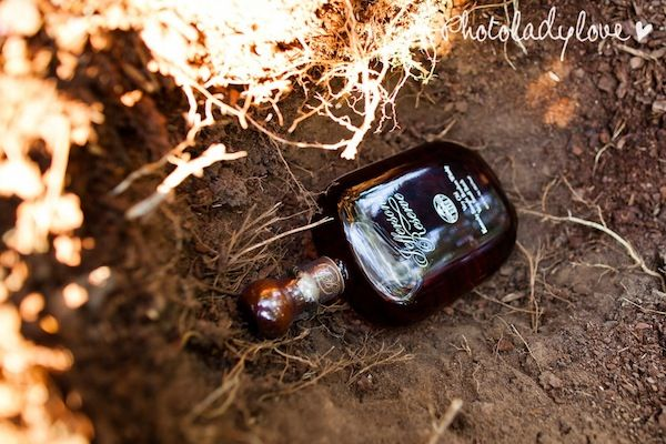 Southern folklore says that if you bury a bottle of bourbon at the site where the bride and groom are to be married, then it won't rain on their wedding day. This must be done exactly one month before the wedding, the bottle must be completely full and it must be buried upside down. I love southern folklore :)