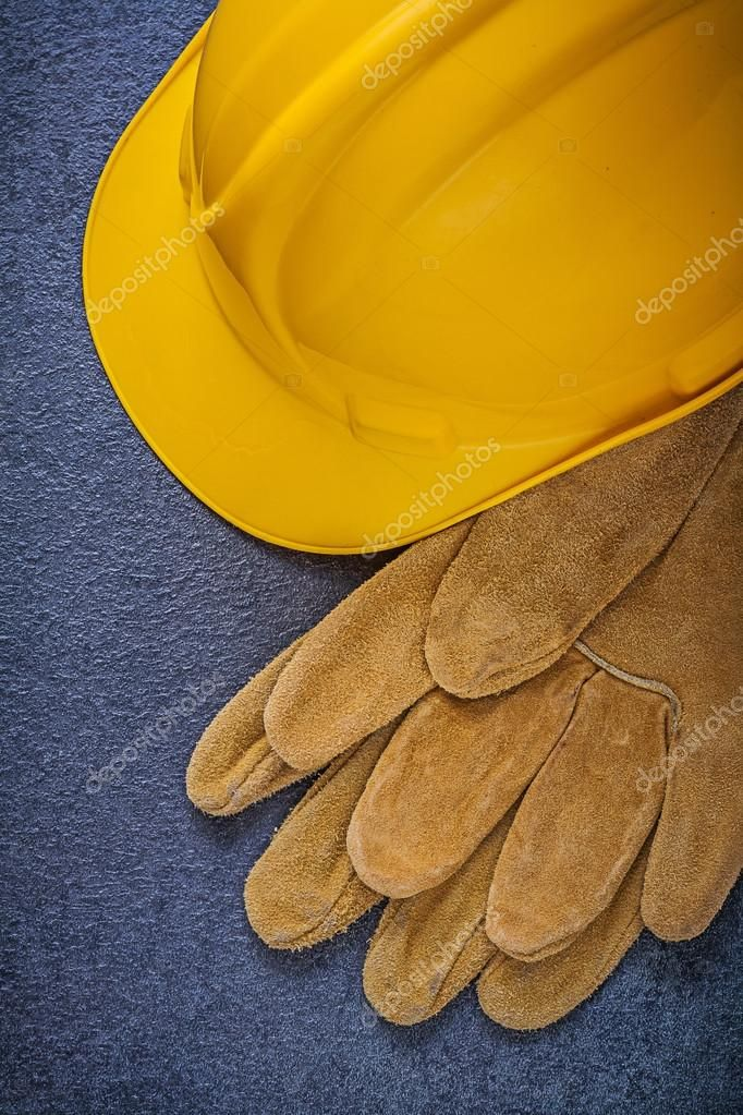 Safety hard hat and leather gloves Royalty Free Stock