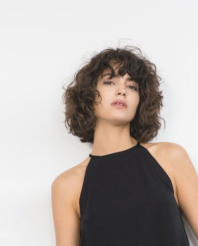 Short Naturally Wavy Hair With Bangs For Curly