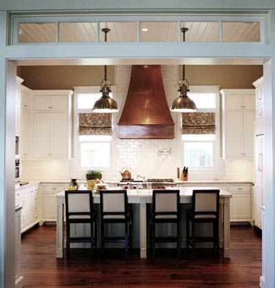 White Kitchen With Copper Hood And Chrome Pendants