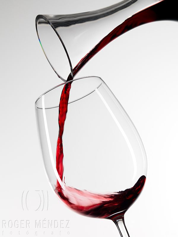 Glass of red wine and decanter
