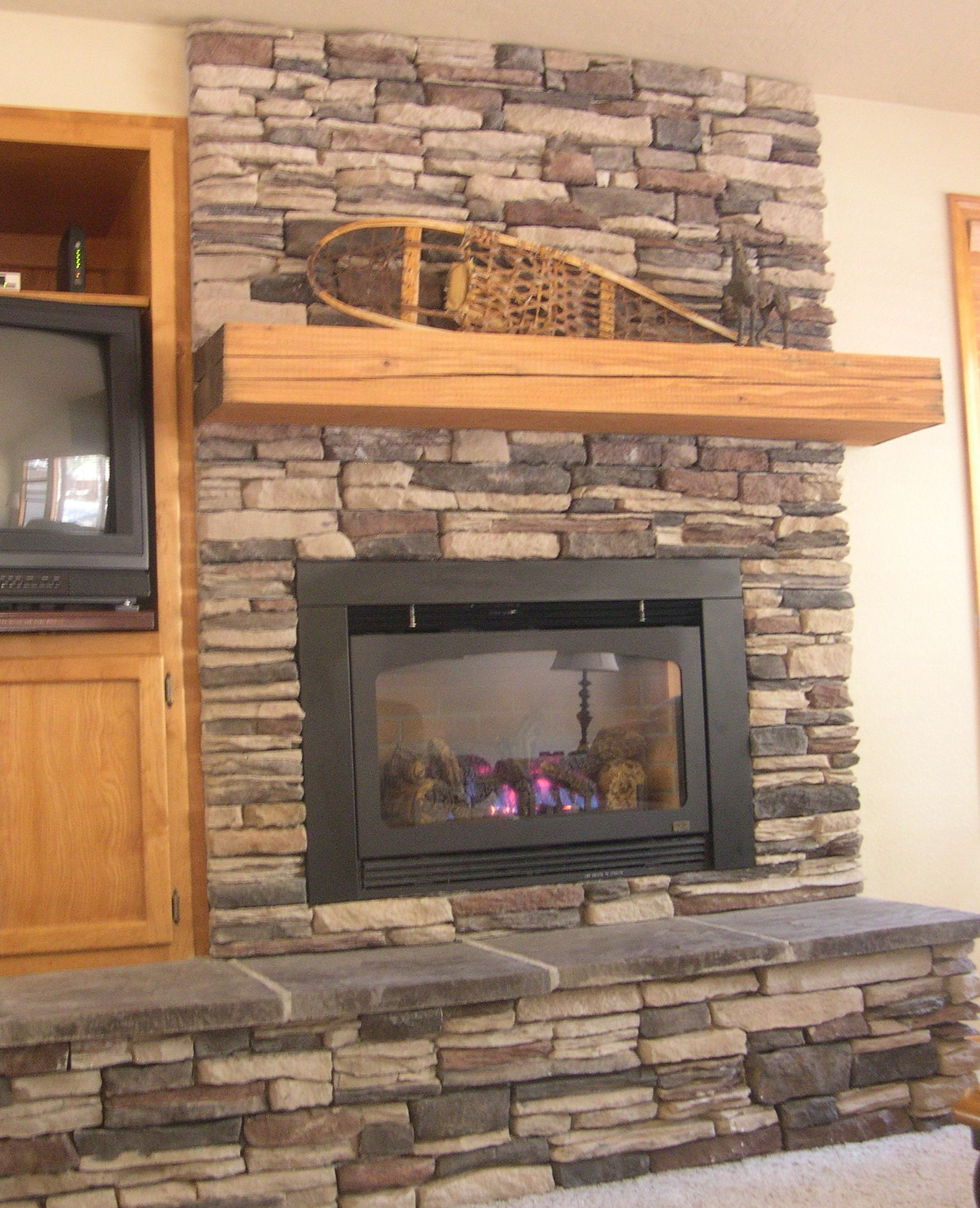 Stacked Stone Fireplace Surround faux stacked stone paint treatment | racks and wooden television