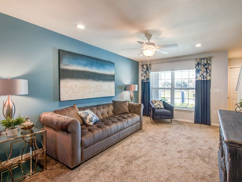 Blue green accent wall in a living