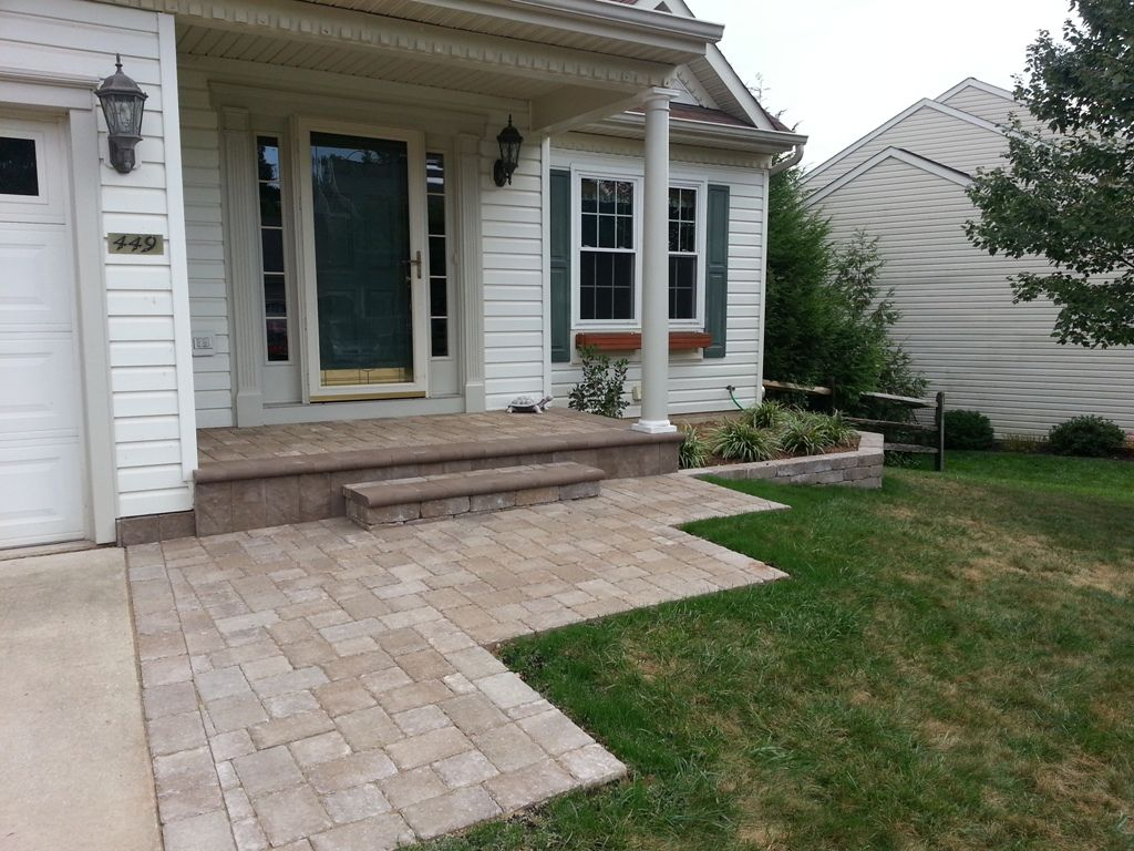 A Porch Overlay With Paver Brick And A New Sidewalk Transformed The Front Entrance To This Home It I Brick Porch Brick Paver Patio Small Front Porches Designs