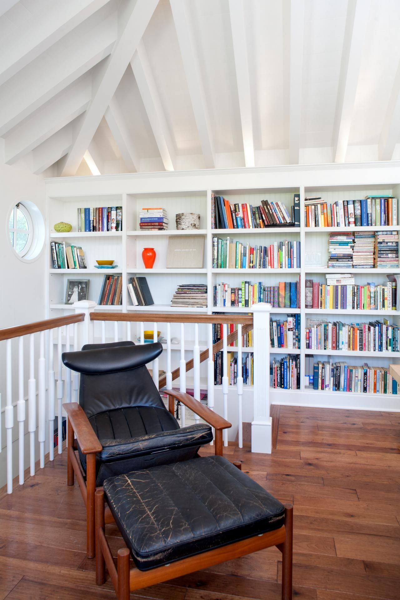 traditional hidden home office. The Home Office Is Lined With Custom Bookshelves That Have Uplighting Hidden Behind Crown. Complete A Vintage Leather Armchair, Space Traditional