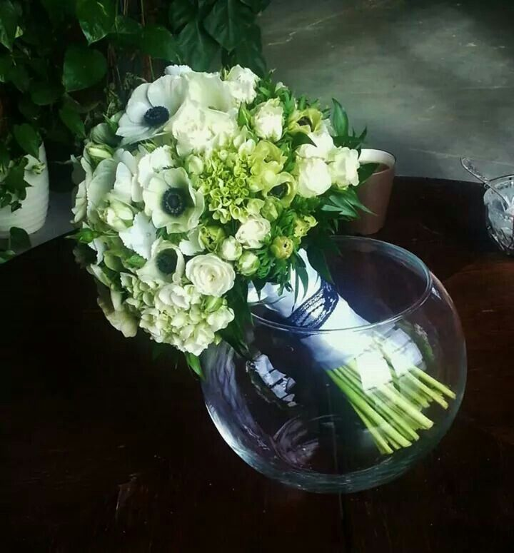 Bridal boquet with white anemones, hydrangea and roses.