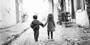 Captured moment of two child friends holding hands  | Hand n
