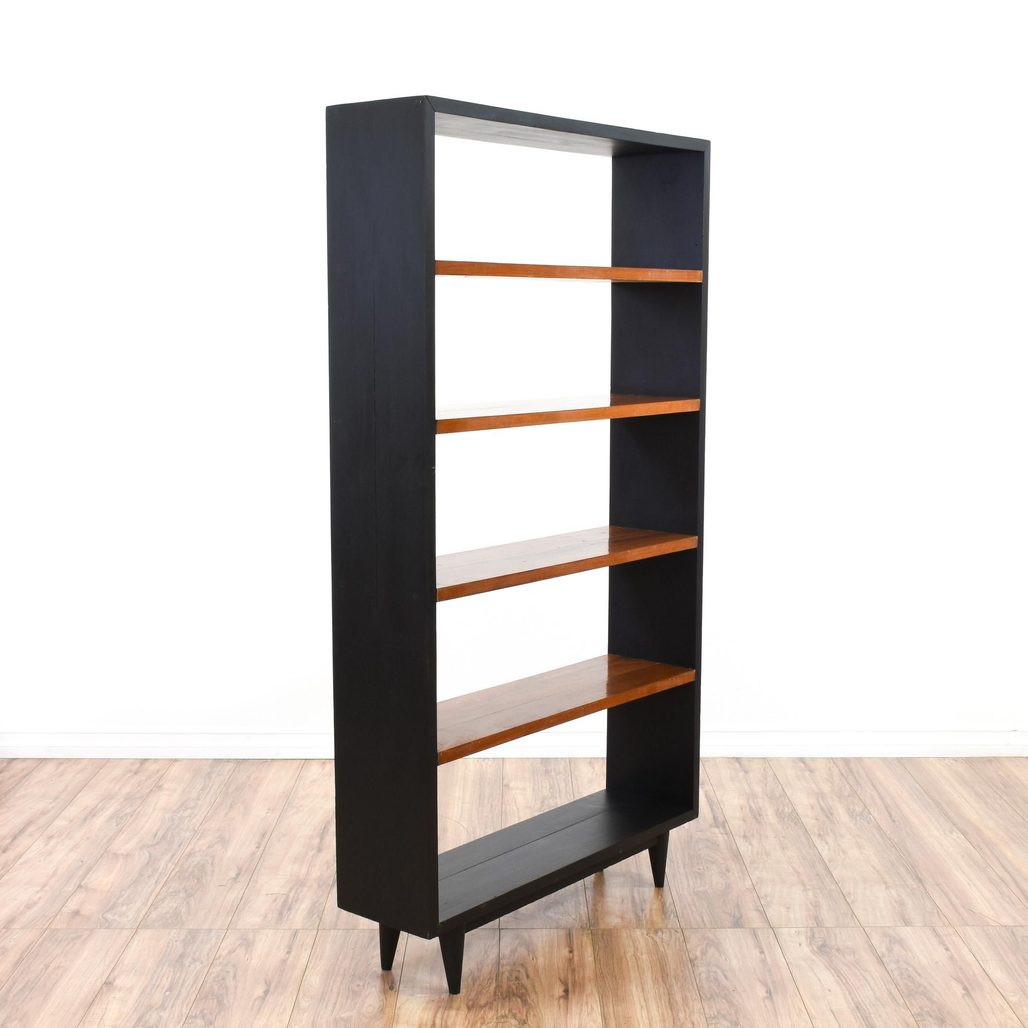 This mid century modern bookshelf is featured in a solid wood with a