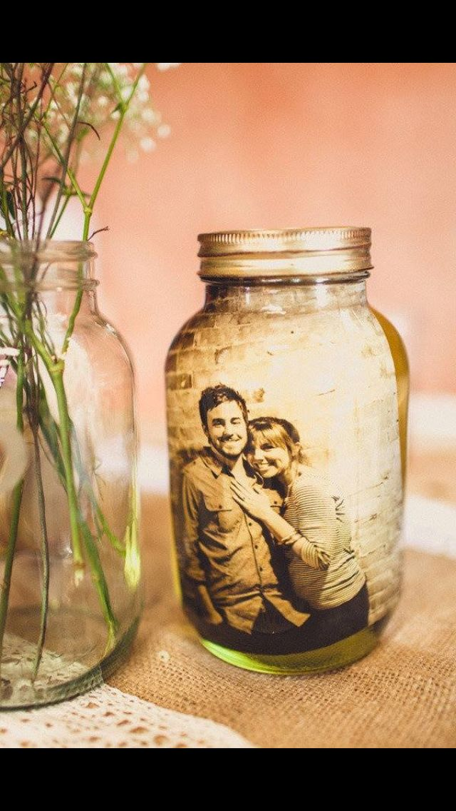 Awesome idea! Laminated photos in mason jars. I think I would add glitter to make like a home-made photo snow globe