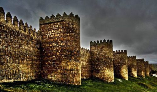 """"""" Avila - Town Walls """"    This image shows a part of the amazing """" AVILA - Town Walls """". From Romans built, the wall has a lenght of 2600 m, a height of 12 m and is up to 3 m thick. With intervals of each 20 m, the wonderful located town AVILA is sourrounded by 88 semicircular towers."""