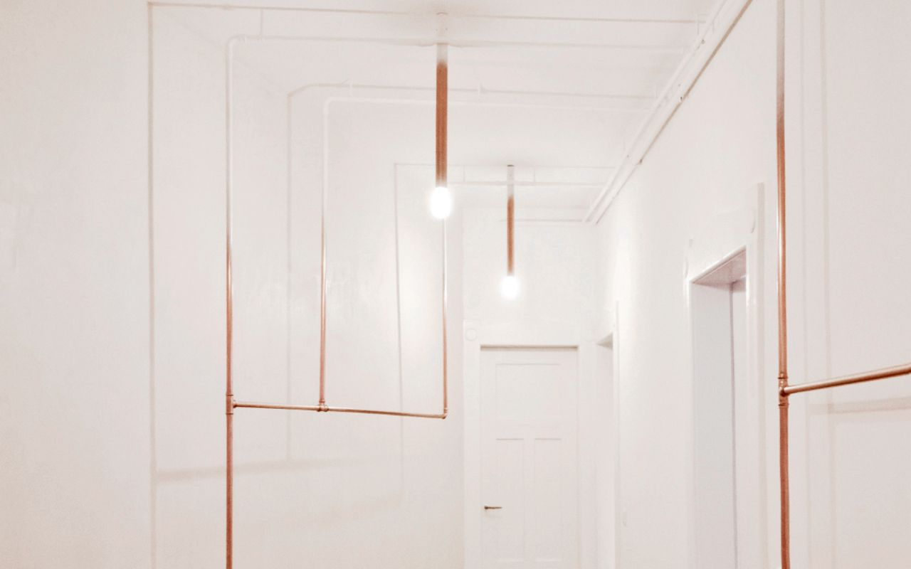 Gradient copper tube installation by STUDIO DLF - Daniele Luciano Ferrazzano. http://studio-dlf.com/tu-90-interior/  Project: TÜ90 INTERIOR Renovation and Interior concept.