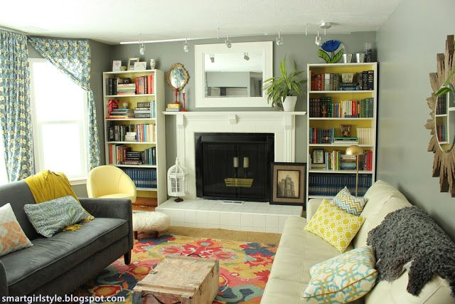 Freshening up a living room with colorful books in some bookcases.