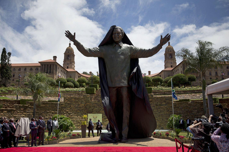 30-foot statue of Nelson Mandela unveiled in Pretoria, South Africa  (Photo: Matt Dunham / AP)