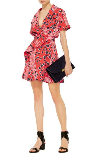 This short sleeve crepe **Carven** dress features an abstract underwater print, a mini length asymmetric hem, and a peplum design at the waist.
