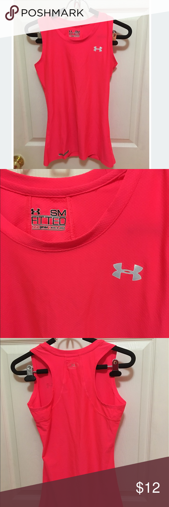 Women's under armor fitted dry fit workout tank Women's under armor fitted dry fit workout tank. Heat gear. Neon pink. Great workout tank, wicks sweat. Used great condition. Size small. Under Armour Tops Tank Tops