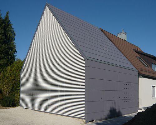 rasant inszenierung der silberpfeile dachs fassaden und architektur. Black Bedroom Furniture Sets. Home Design Ideas