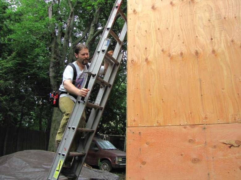 Malcolm Smith works on the exterior of his concise abode in the rear yard of a Claremont Avenue residence.