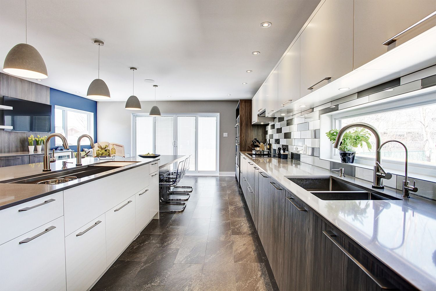 A Spacious Contemporary Kitchen Equipped With Two Sinks What S