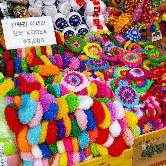 A rainbow of fuzzy....? Pot holders? Soap covers? Sink cleaners? Loofahs? I've never figured out what these things found in every traditional Korean market actually are. What would YOU use it for? by (modern_mumu). worldtravelpics #worldnomads #travelgram #passionpassport #mytinyatlas #traveltodaytv #colorful #korea #acolorstory #livecolorfully #welltraveled #travelstroke #ig_korea #darlingescapes #myunicornlife #traveldeeper #neverstopexploring #abmlifeiscolorful #travelphotography…