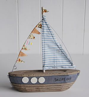 A Small Decorative Wooden Boat The White Lighthouse