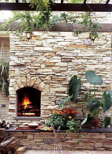 Limestone outdoor fireplace.