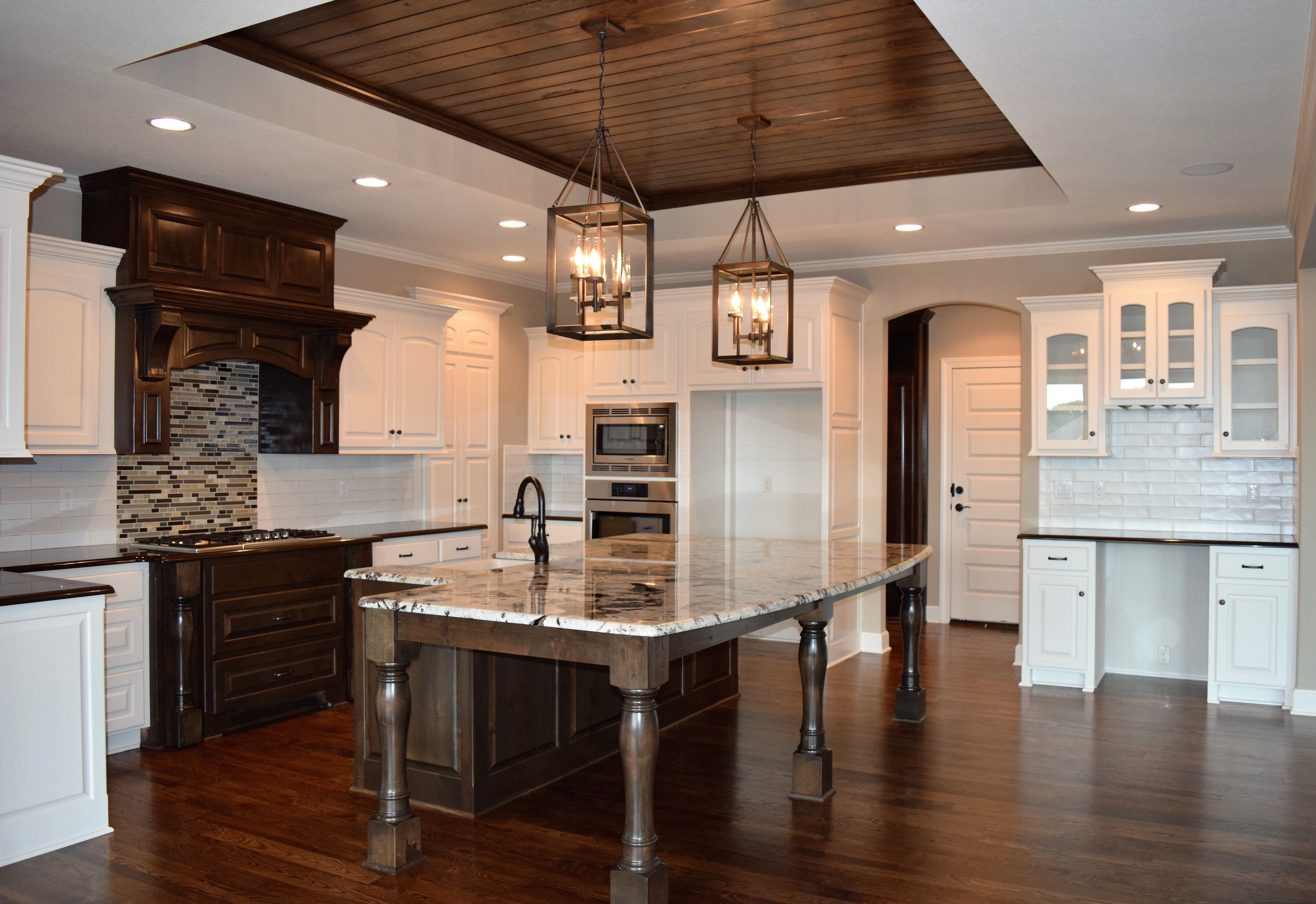 lantern kitchen island lighting. Large Granite Island, White Cabinets, Wood Ceiling Accent, Two Toned Lantern Kitchen Island Lighting