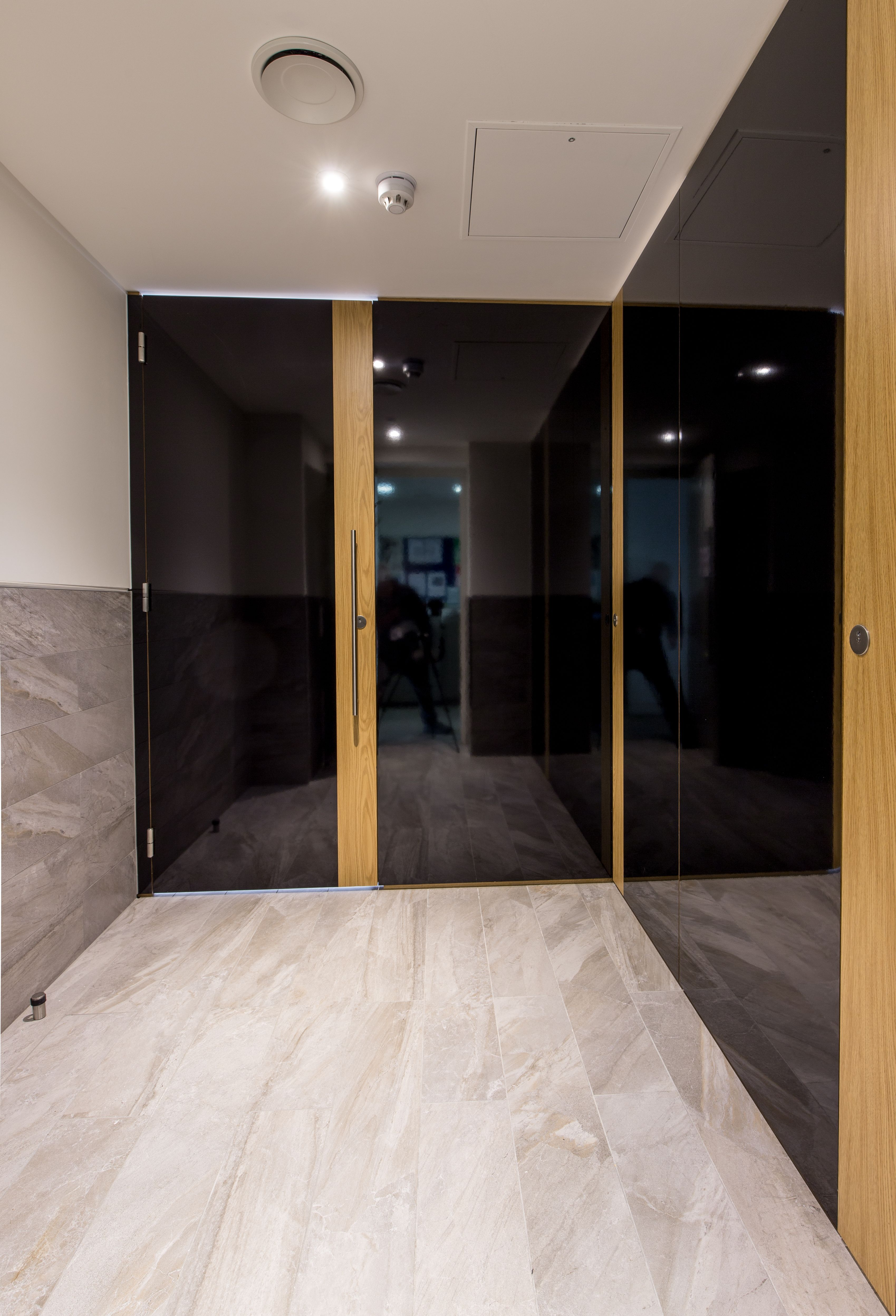 Full height Alto toilet cubicles faced in black Formica AR Plus