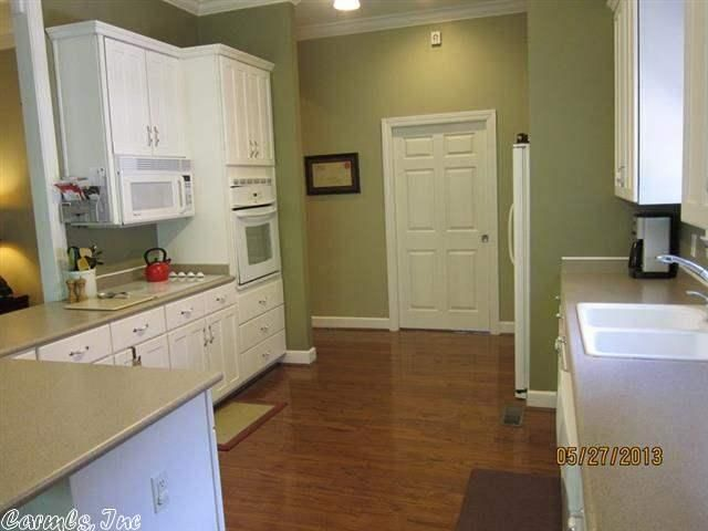 White cabinets with white appliances. 23 Briar Patch Court ...