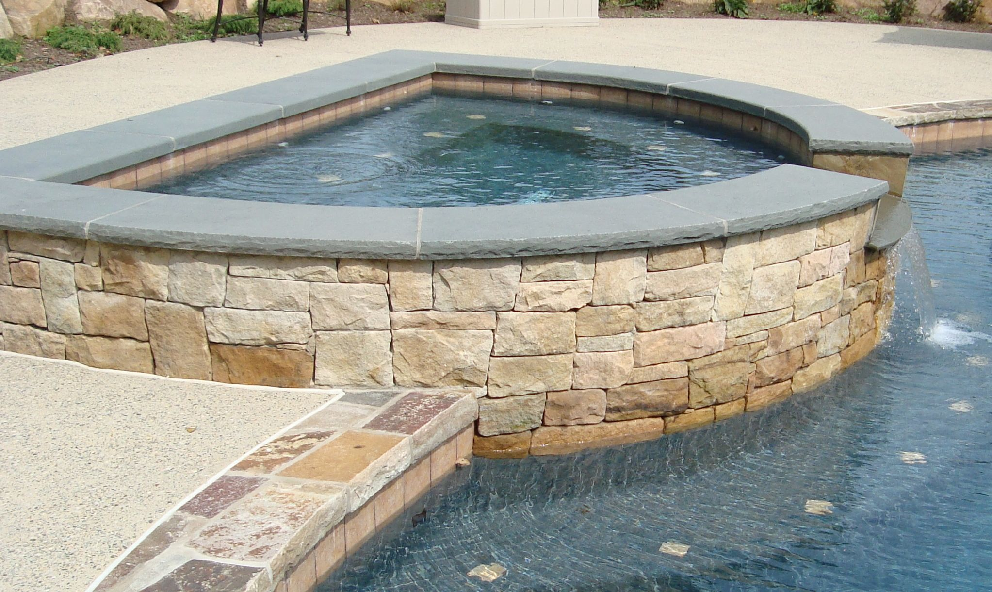 Custom Pool And Spa With Blue Stone Coping And Natural Stone Raised Spa Pool Designs