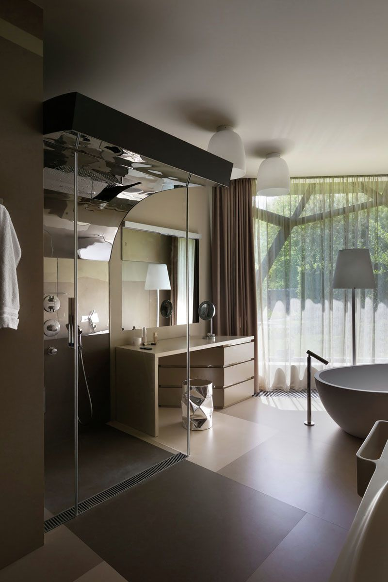 Safe Room Design: This Contemporary Shower Has A Curved Ceiling And A Safe