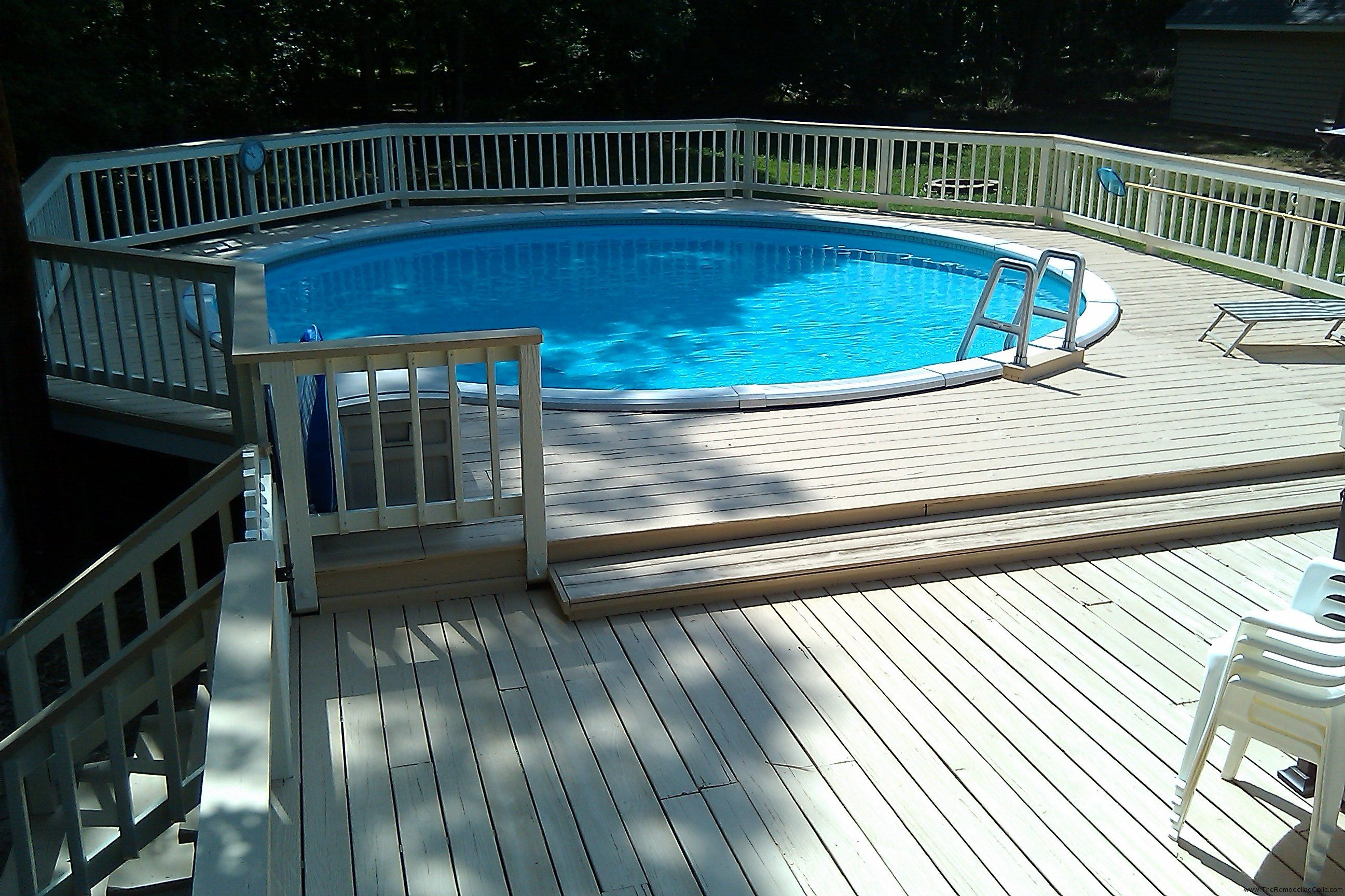 unique wooden deck above ground small backyard pools ideas with round shape design