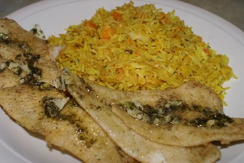 Good Friday Meal-Lightly Fried Fish with Garlic,Lemon Butter On A Bed of Rice & Lentils- Cost $ 1.93 each