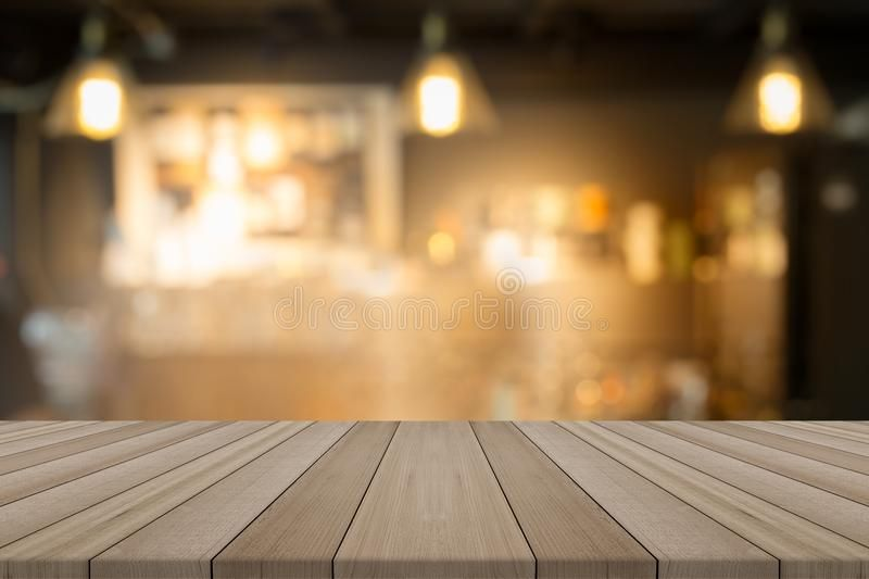 Empty wood table top on blurred background form coffee