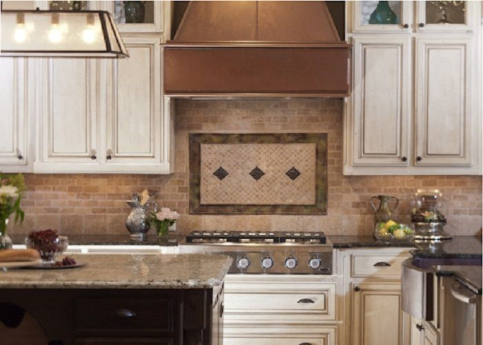 Elegant Rustic Kitchen With Copper Vent Hood And Copper Accent Tiles