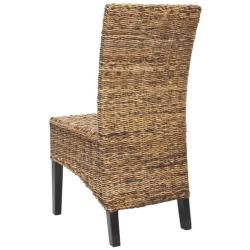 These St. Croix chairs bring a piece of the resorts to any room. This set of two chairs features beautifully woven natural tan wicker, a sturdy wood frame and a supportive and cool design for maximum comfort.