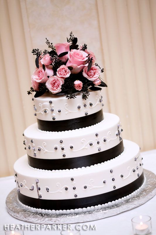 white and black wedding cake with a hint of pink