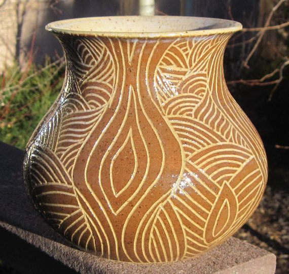 Vase with beautiful hand carved design  Please by thewheelandi