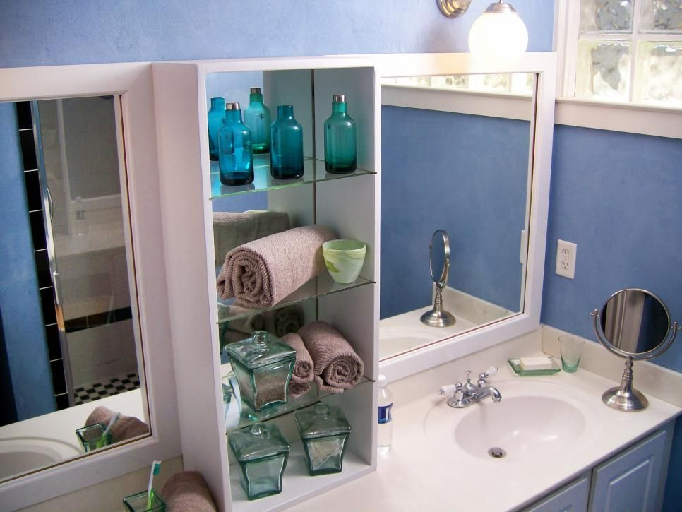 a simple vanity was given a vertical uplift with a narrow glass storage cabinet bathroom