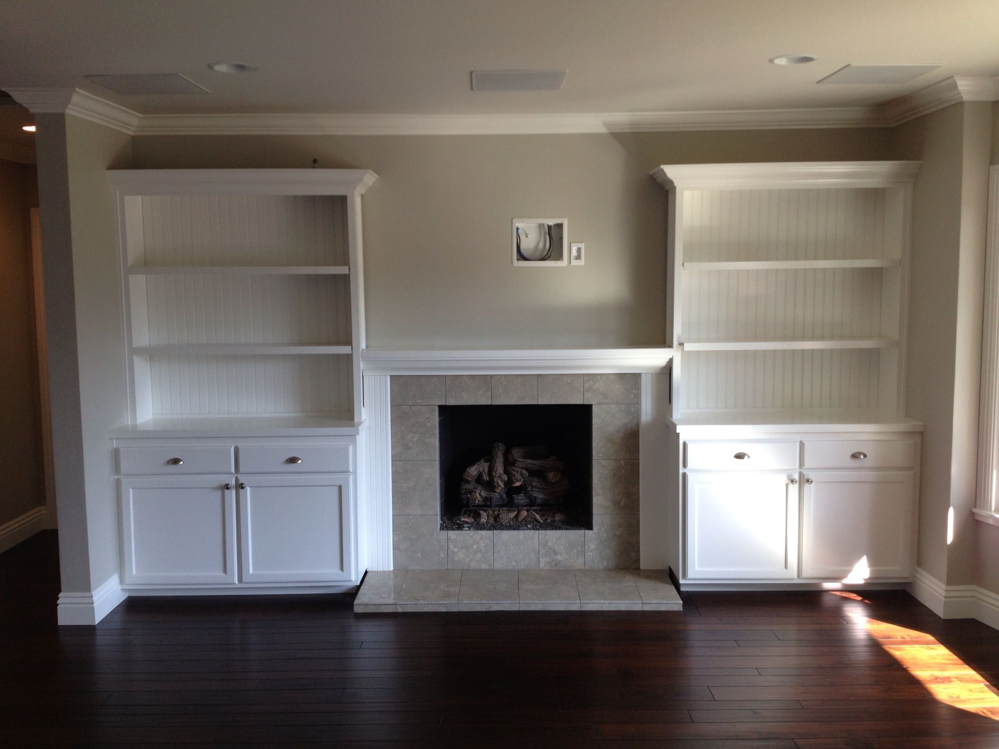 Built in cabinets around fireplace for the home in