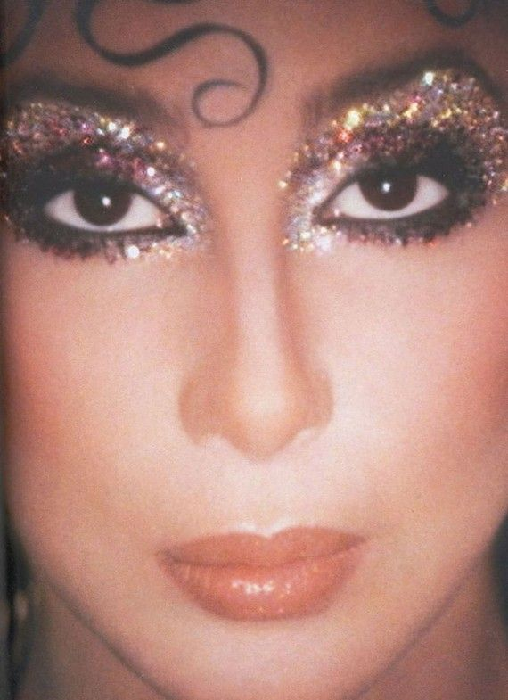Cher in the 1970s, modelling glittery disco style. Makeup and photograph by Kevyn Aucoin