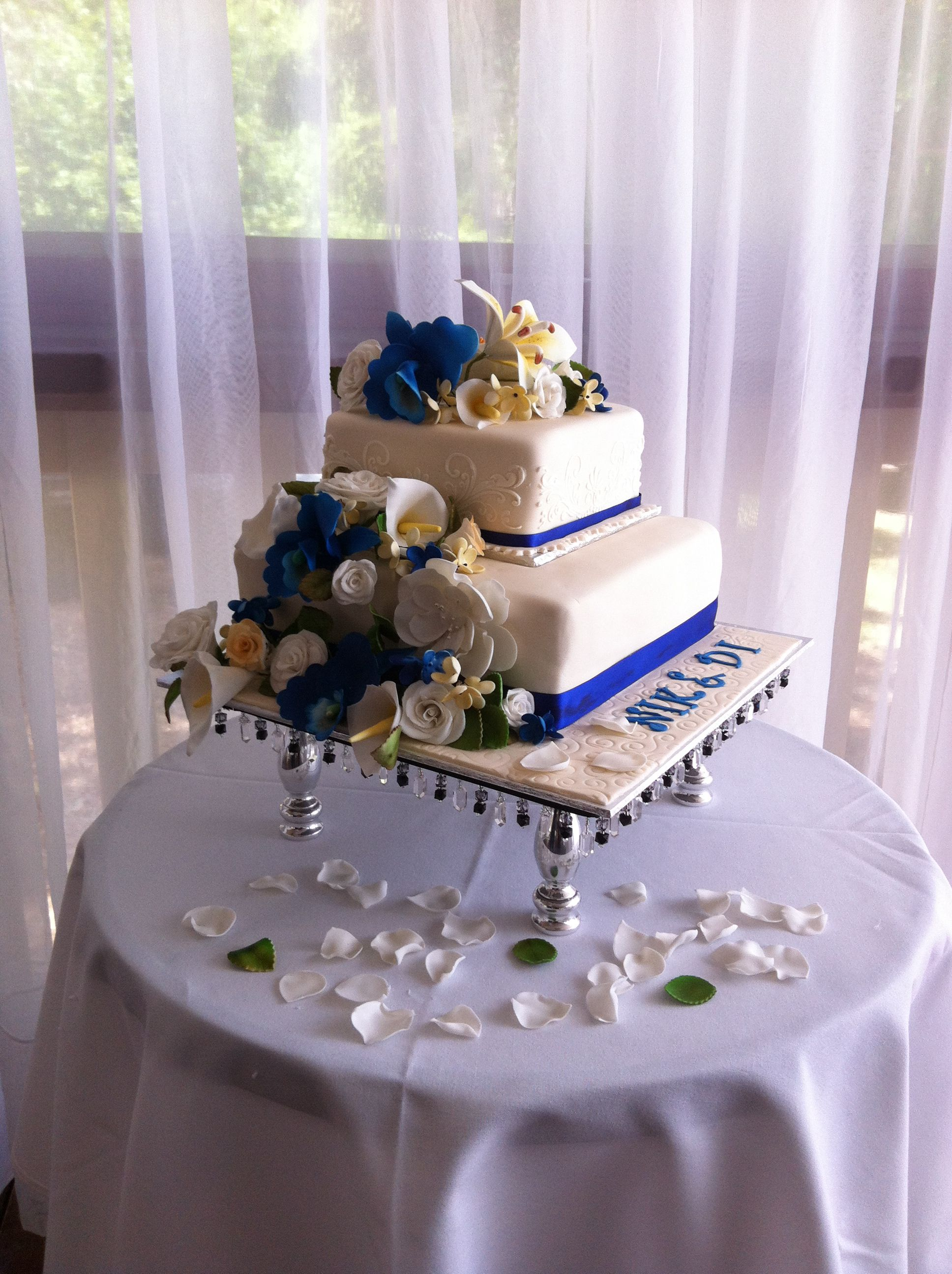 2 tier wedding cake with blue white yellow flowers wedding ideas 2 tier wedding cake with blue white yellow flowers izmirmasajfo Images