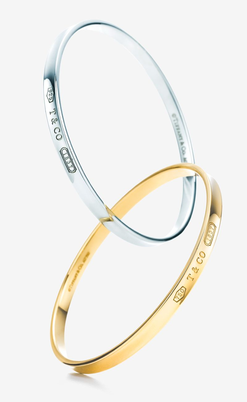10ff104e6 A Tiffany 1837™ interlocking circles bangle in 18k gold and sterling silver  makes a perfect holiday gift.