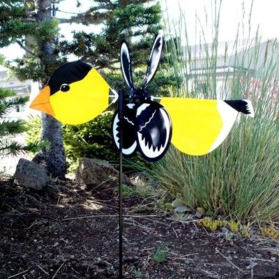 Gold Finch Baby Bird.  Baby Goldfinches are the perfect size measuring 19 x 12 with a 17 inch pole. They will bring kinetic accent colors to gardens, flower pots and planters. Made with weather resistant polyester fabric. The Bugs unique markings have been printed. They are made with durable fiberglass forms and pole. They are oh so cute and easy to assemble. #goldfinch #windspinner #gardendecor