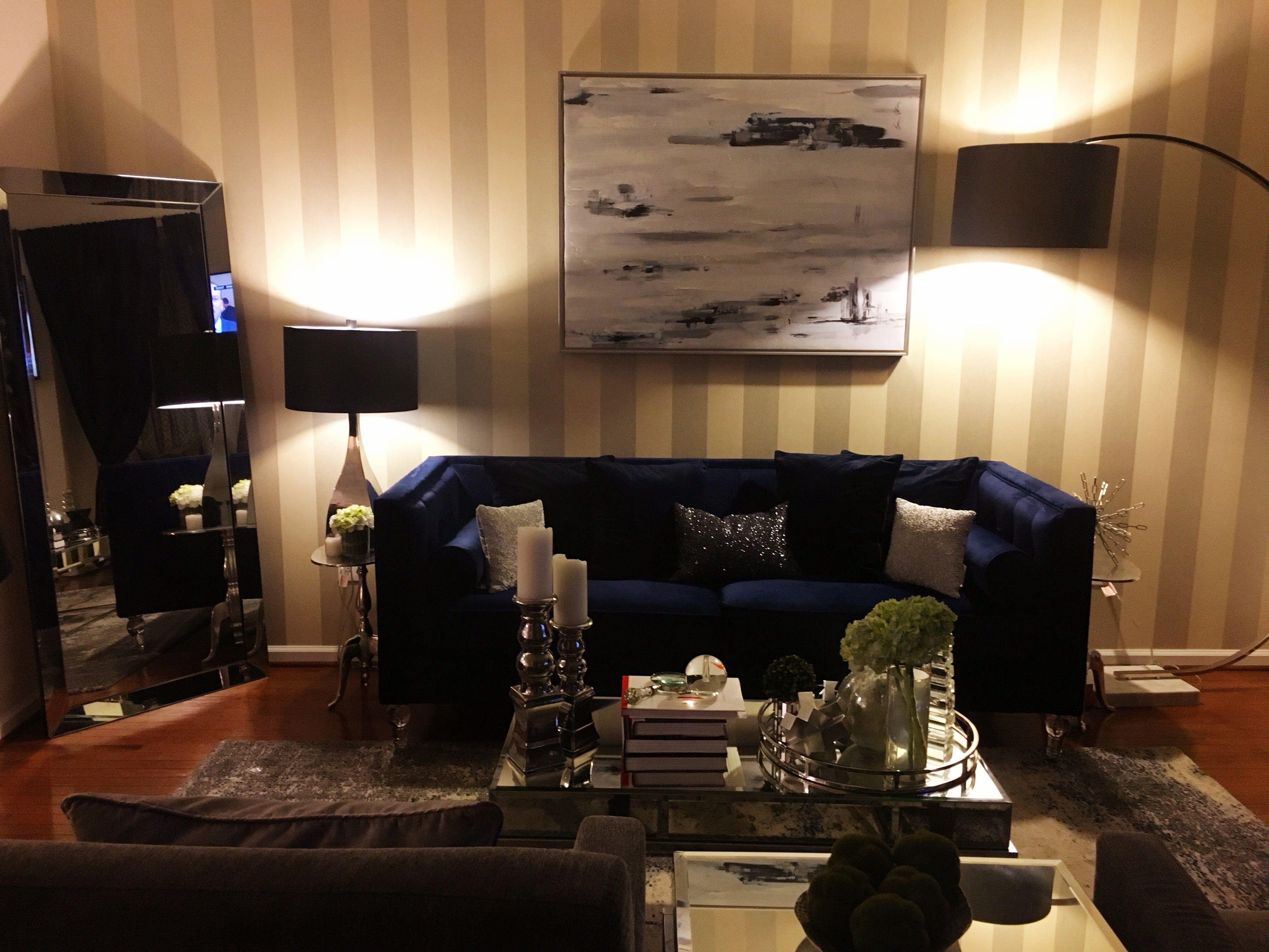 Gray & white striped wallpaper, blue velvet couch, mirror