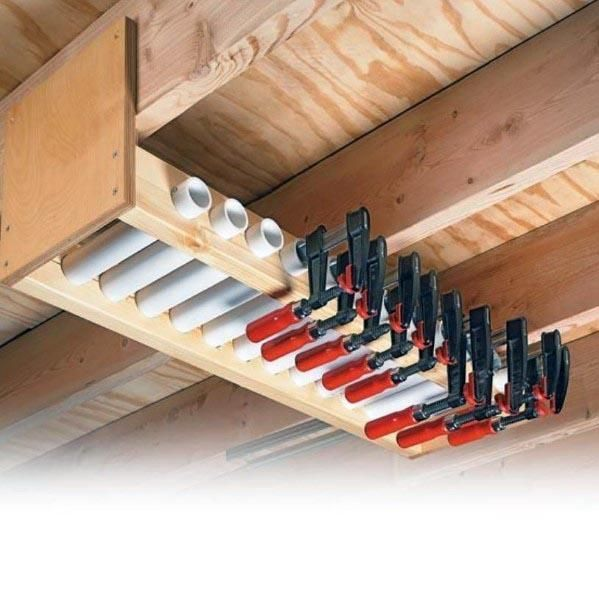 Top 80 Best Tool Storage Ideas - Organized Garage Designs Pvc Pipe Overhead Ceiling Clamps Tool Storage Ideas #toolstorage