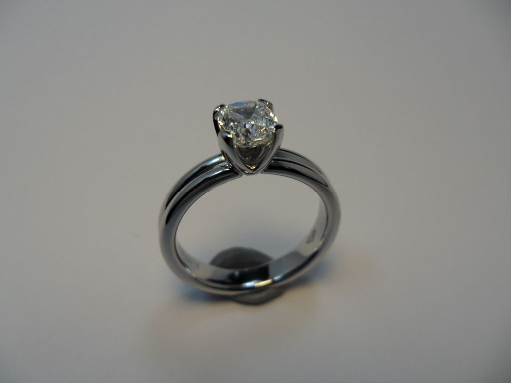Large 1ct Radiant cut Diamond of exceptional clarity, set in a 4 prong Platinum setting on a double Pt Ringband.