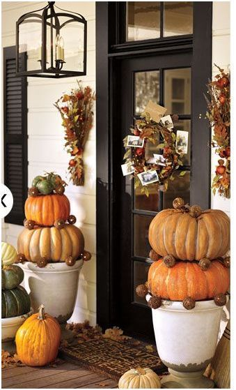Pottery Barn fall front porch with pumpkin topiaries. Love.
